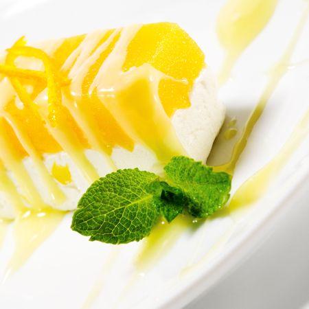 Dessert - Orange Cheesecake with Fresh Mint Stock Photo - 5711040