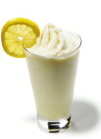 slices of lemon: Smoothie - Honey and Mango Served with Lemon Slice