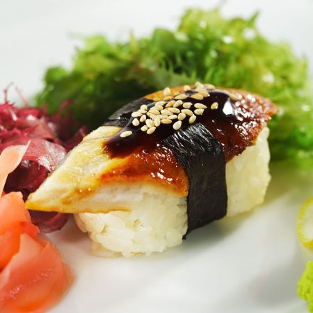 Japanese Cuisine -  Eel Nigiri Sushi with Ginger and Seaweed