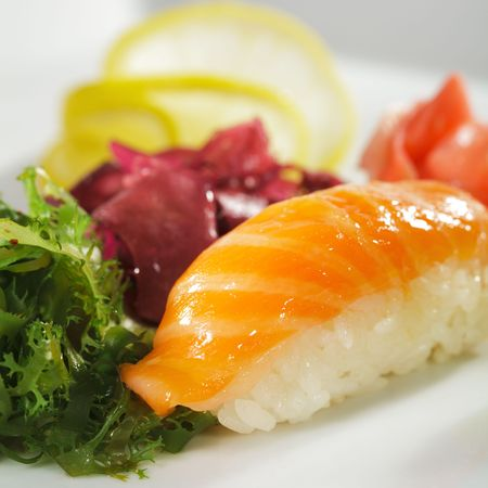 Japanese Cuisine -  Salmon Nigiri Sushi with Ginger and Seaweed photo