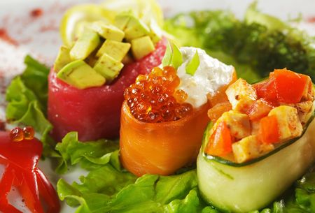 sushi roll: Different types of Gunkan Maki Sushi - Tuna and Salmon and Cucumber Wrap Stock Photo