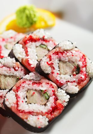 Roll with Smoked Salmon, Tamago (japanese omelet), Tobiko (flying fish roe) and Cucumber inside Stock Photo - 5925232