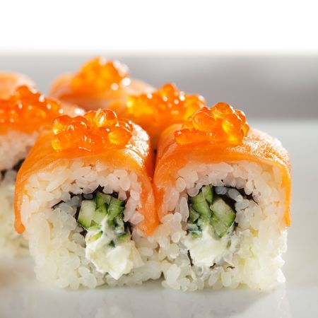 Roll with Cream Cheese and Cucumber inside. Smoked Salmon and Ikura (Salmon Caviar) outside Stock Photo - 5925240