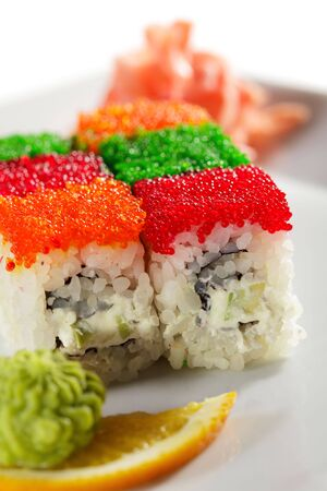 Tobiko Rainbow Maki Sushi - Roll with various type of Tobiko (flying fish roe) outside. Cream Cheese, Fresh Raw Salmon and Avocado inside photo