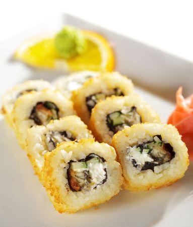 Unagi Fry Maki Sushi - Roll made of Smoked Eel, Cream Cheese and Cucumber photo