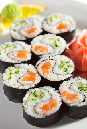 Yin Yang Maki Sushi - Roll made of Fresh Salmon and Cucumber inside. Nori Outside Stock Photo - 5925164