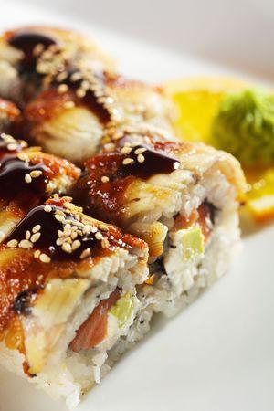 Roll made of Fresh Raw Salmon, Smoked Eel, Cream Cheese and Avocado inside. Unagi (Eel) outside photo