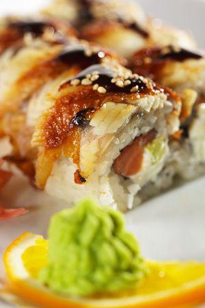 sake: Roll made of Fresh Raw Salmon, Smoked Eel, Cream Cheese and Avocado inside. Unagi (Eel) outside