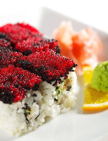 Night City Maki Sushi - Roll made of Cream Cheese, Tamago (japanese omelet), Cucumber and Smoked Eel inside. Tobiko (flying fish roe) outside Stock Photo - 5925260