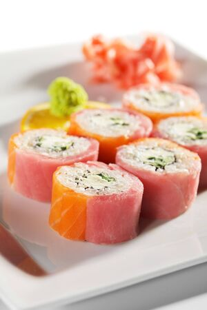VIP Philadelphia Maki Sushi - Roll made of Cream Cheese and Cucumber inside. Fresh Salmon and Tuna outside photo