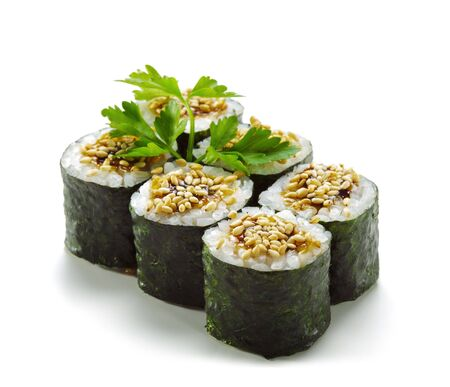 Unagi Maki - Smoked Eel Sushi Roll. Topped with Eel Sauce and Sesame. Served with Parsley photo
