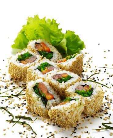 Maki Sushi - Roll with Smoked Salmon, Sweet Pepper, Salad Leaf and Chuka Seaweed inside. Sesame outside. Served with Salad Leaf photo