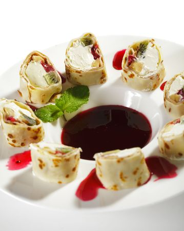 Dessert Sushi Rolls - Kiwi, Banana and Strawberry with Cream Cheese wrapped in Eggs Pancake photo