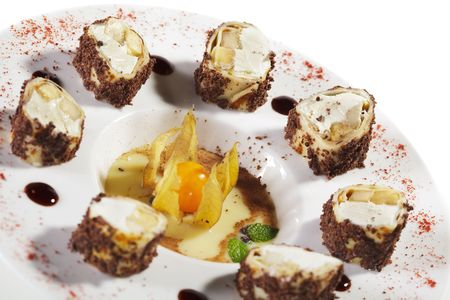 Dessert Sushi Rolls - Banana and Pear with Cream Cheese wrapped in Eggs Pancake with Cocoa Powder photo
