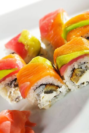 Rainbow Roll - Eel and Cream Cheese inside. Tuna, Salmon and Avocado outside Stock fotó