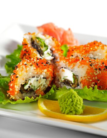 Sushi Roll with Eel, Fresh Cucumber, Salad Leaf and Cream Cheese inside. Tobiko (flying fish roe) and Sesame outside photo