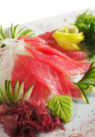 Tuna Sashimi - Sliced Raw Tuna on Daikon (White Radish) with Seaweed and Cucumber photo