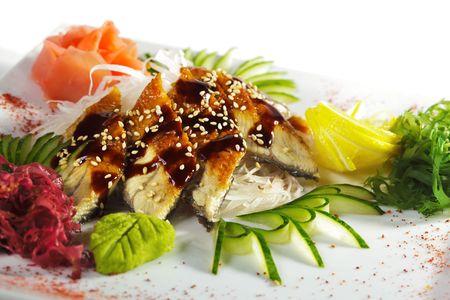 tare: Unagi Sashimi - Smoked Eel on Daikon (White Radish) with Eel Sauce and Sesame. Served with Seaweed, Cucumber and Lemon