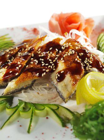 Unagi Sashimi - Smoked Eel on Daikon (White Radish) with Eel Sauce and Sesame. Served with Seaweed, Cucumber and Lemon Stock Photo - 5925222