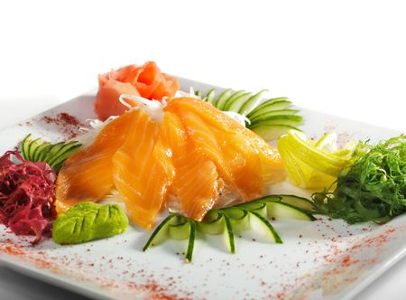 Salmon Sashimi - Sliced Raw Salmon on Daikon (White Radish) with Seaweed and Cucumber photo