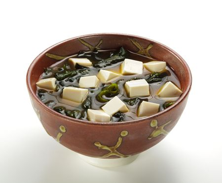 Japanese Cuisine - Miso Soup with Seaweed, Mushrooms and Tofu Cheese photo