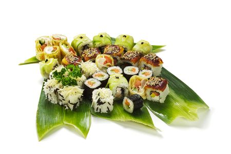 Sushi Set - Different Types of Maki Sushi (Yin Yang Roll, Salmon and Smoked Eel Roll, Cucumber Roll, Caesar Roll, Sweet Fruit Roll). Served on Green Leaves Stock Photo - 5925236