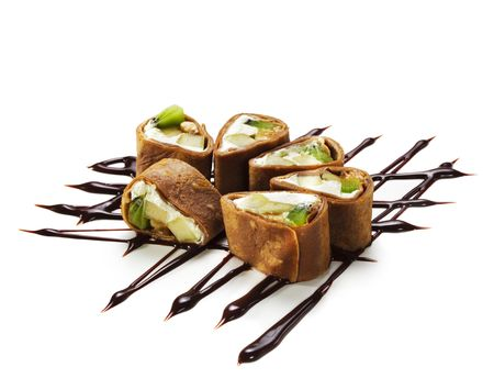Dessert Maki Sushi - Chocolate Roll with Various Fruit and Cream Cheese inside. Chocolate Pancake outside. Served on Chocolate Pattern photo