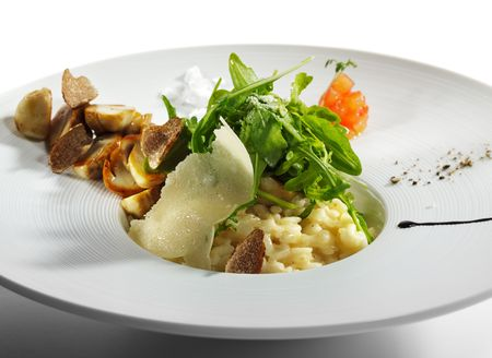 Risotto with Rucola, Tartufo Bianco (White Truffle) and Porcini and Tomato Stock Photo