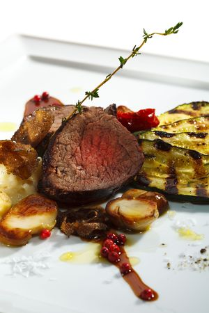 Prime Veal with Risotto, Tartufo Nero (Black Truffle), Zucchini Grill, Porcini and Dried Tomato Stock Photo - 5972312