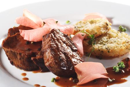 Beef Plate with Potatoes Galette Served with Boiled Rose Petal and Wine Sauce photo