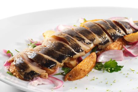 Sliced Fish Served with Baked Potatoes and Salad photo