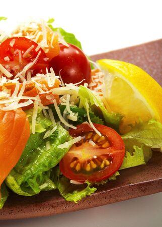 Japanese Cuisine - Salad made of Fresh Salmon, Salad Leaf, Cherry Tomato, Lemon and Parmesan Cheese Stock Photo - 6549657