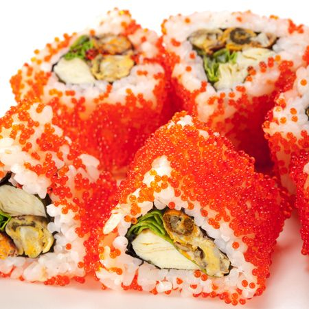 Mussel Maki Sushi - Roll made of Mussels, Tamago (japanese omelet) and Salad Leaf inside. Red Tobiko (flying fish roe) outside photo
