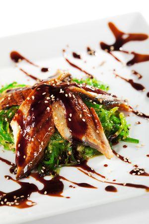 tare: Japanese Cuisine - Chuka Seaweed and Unagi (smoked eel) Salad with Nuts Sauce. Topped with Eel Sauce and Sesame