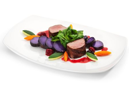 venison: Venison Meat with Carrots, Zucchini, Herbs and Blue Potato. With Sauce and Red Berries