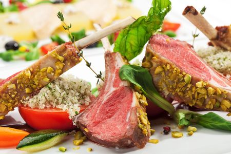 Roasted Lamb Chops with Pistachio. Garnished with Vegetables and Basil Stock fotó