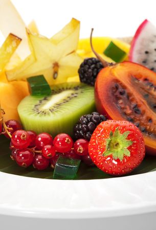 small plate: Exotic Fruit Dish with Mint Jelly. Dragon Fruit, Maracuya, Starfruit, Cantaloupe and Berries