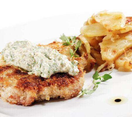 Pork Schnitzel with Fried Potato and Sauce Tartar photo