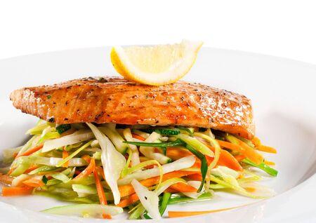 julienne: Fillet of Salmon with Julienne Peeler Vegetable and Lemon Slice Stock Photo