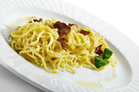 Home made Pasta with Parmesan Cheese and Tartufo Bianco (white truffle). Served with Basil Leaf Stock Photo - 6781303