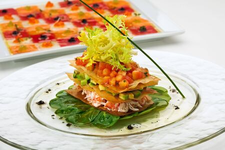 crabmeat: Crab Meat Salad with Tomato and Avocado on Fresh Green Leaves Stock Photo