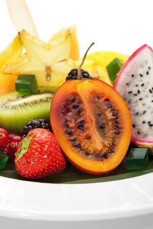 Exotic Fruit Dish with Mint Jelly. Dragon Fruit, Maracuya, Starfruit, Cantaloupe and Berries photo