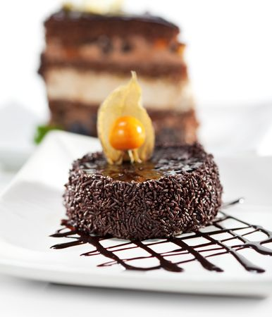 Dessert - Chocolate Iced Cake with Poppy Seed. Selective focus photo