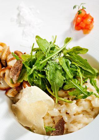 white truffle: Risotto with Rucola, Tartufo Bianco (White Truffle) and Porcini and Tomato Stock Photo