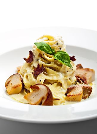 Tagliatelle with Mushroom, Cream Sauce, Truffle and Basil Leaf Stock Photo