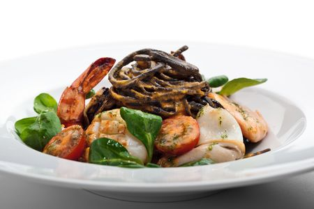 Seafood Spaghetti with Tiger Prawns, Scallops, Mussels, Calamari, Salmon and Tomato Sauce Stock Photo - 6781053