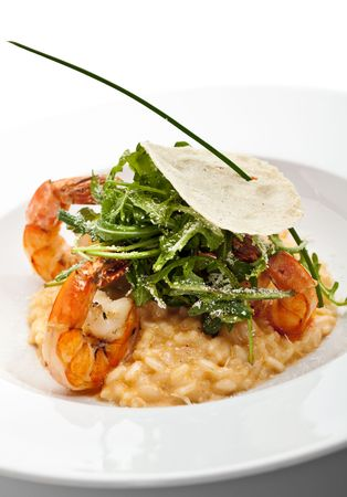 Risotto with Tiger Prawns and Rucola. Served with Parmesan Chip Stock fotó