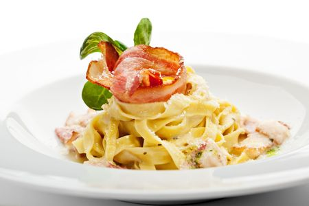 Tagliatelle with Carbonara Sauce, Bacon and Yolk of Quail Egg photo