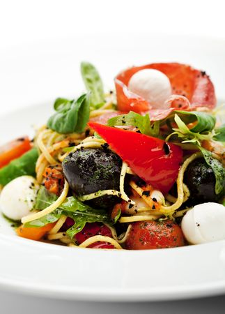 Spaghetti with Vegetables, Ham, Black Olives, Rucola and Pesto Sauce Stock Photo - 6781047