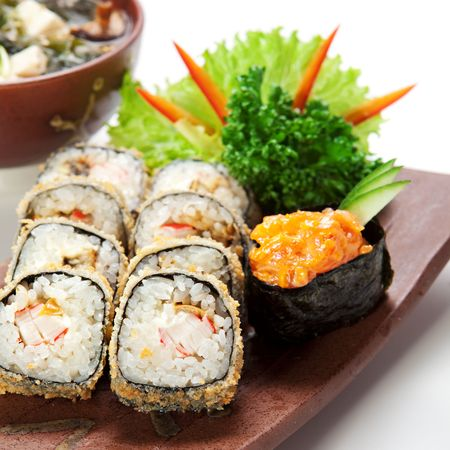 Japanese Cuisine -Tempura Maki Sushi (Deep Fried Roll made of Smoked Eel, Crab Meat and Cream Cheese inside) with Spicy Salmon (sake) Gunkan Sushi and Miso Soup (Seaweed, Mushrooms and Tofu Cheese) Stock Photo - 6781379